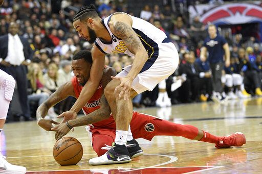 Washington Wizards guard Jordan McRae, back, battles for the ball against Indiana Pacers guard Cory Joseph, front, during the first half of an NBA basketball game, Wednesday, Jan. 30, 2019, in Washington.