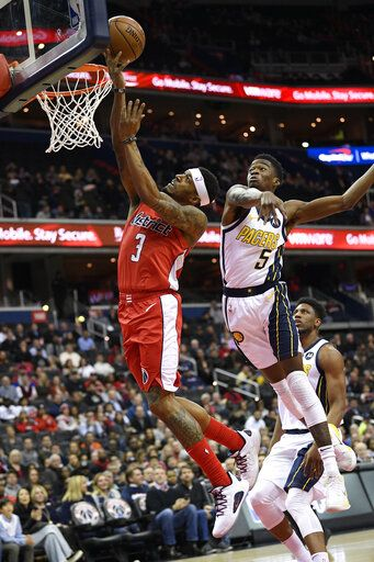 Washington Wizards guard Bradley Beal (3) goes to the basket past Indiana Pacers guard Edmond Sumner (5) during the first half of an NBA basketball game, Wednesday, Jan. 30, 2019, in Washington.