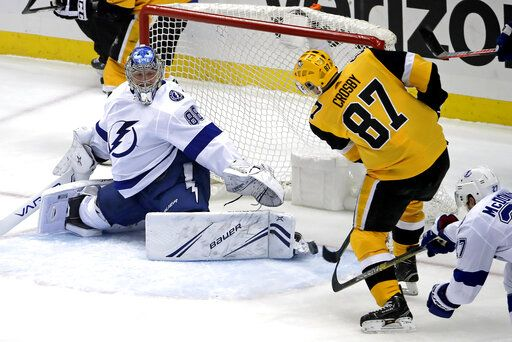 Pittsburgh Penguins' Sidney Crosby (87) puts the puck past Tampa Bay Lightning goaltender Andrei Vasilevskiy (88) for a goal in the first period of an NHL hockey game in Pittsburgh, Wednesday, Jan. 30, 2019.