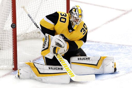 Pittsburgh Penguins goaltender Matt Murray blocks a shot during the first period of an NHL hockey game against the Tampa Bay Lightning in Pittsburgh, Wednesday, Jan. 30, 2019.