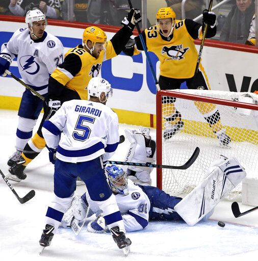 Pittsburgh Penguins' Riley Sheahan (15) celebrates his goal past sprawling Tampa Bay Lightning goaltender Andrei Vasilevskiy (88) with Teddy Blueger (53) during the first period of an NHL hockey game in Pittsburgh, Wednesday, Jan. 30, 2019.
