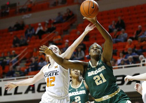 Oklahoma State forward Vivian Gray (12) and Baylor center Kalani Brown (21) reach for a rebound in the first half of an NCAA college basketball game in Stillwater, Okla., Wednesday, Jan. 30, 2019.