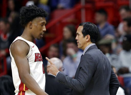 Miami Heat head coach Erik Spoelstra, right, talks with guard Josh Richardson during the first half of an NBA basketball game against the Chicago Bulls, Wednesday, Jan. 30, 2019, in Miami.