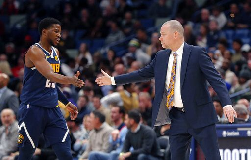 Denver Nuggets coach Michael Malone greets Denver Nuggets guard Malik Beasley (25) as he walks to the bench during a timeout in the second half of the team's NBA basketball game against the New Orleans Pelicans in New Orleans, Wednesday, Jan. 30, 2019. The Nuggets won 105-99.