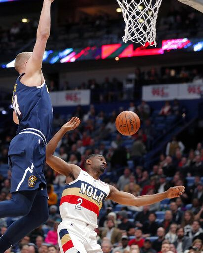 New Orleans Pelicans guard Ian Clark (2) battles under the basket with Denver Nuggets forward Mason Plumlee during the first half of an NBA basketball game in New Orleans, Wednesday, Jan. 30, 2019.