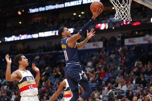 Denver Nuggets guard Monte Morris (11) goes to the basket in front of New Orleans Pelicans guard Frank Jackson (15) during the first half of an NBA basketball game in New Orleans, Wednesday, Jan. 30, 2019.
