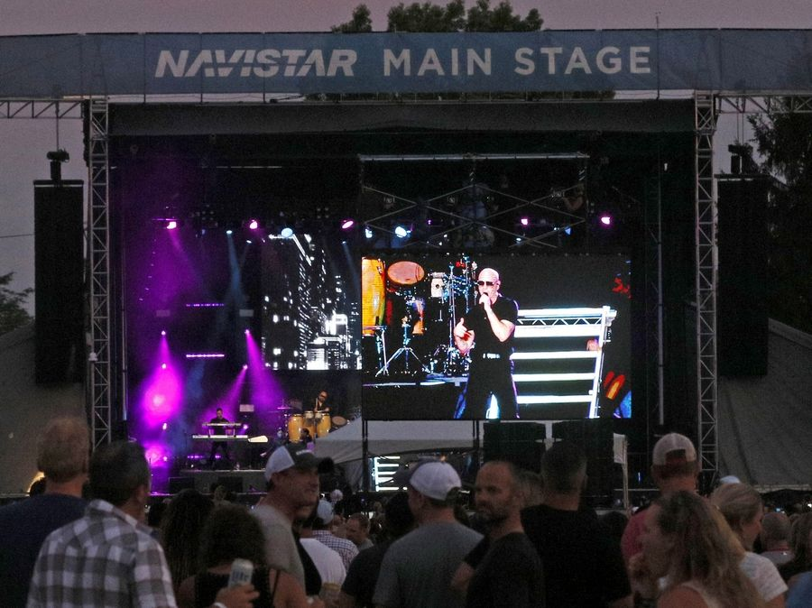 Over its 31 years, Ribfest in Naperville has grown in size and scope, becoming a major concert venue for performers such as Pitbull, seen here on the Ribfest stage in July 2018. Naperville city officials now are asking organizers to consider changing the scale of the festival so it can remain in Naperville, even after its site in Knoch Park becomes unavailable in 2020.