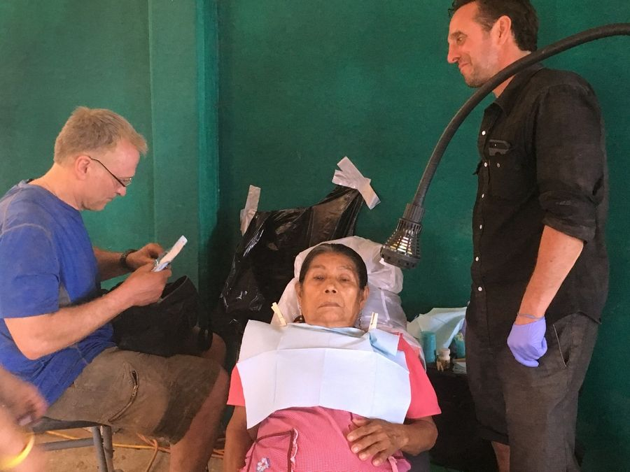 Dr. Tim McBride, left, and Ike Reilly provide dental care to a remote area on a previous trip.