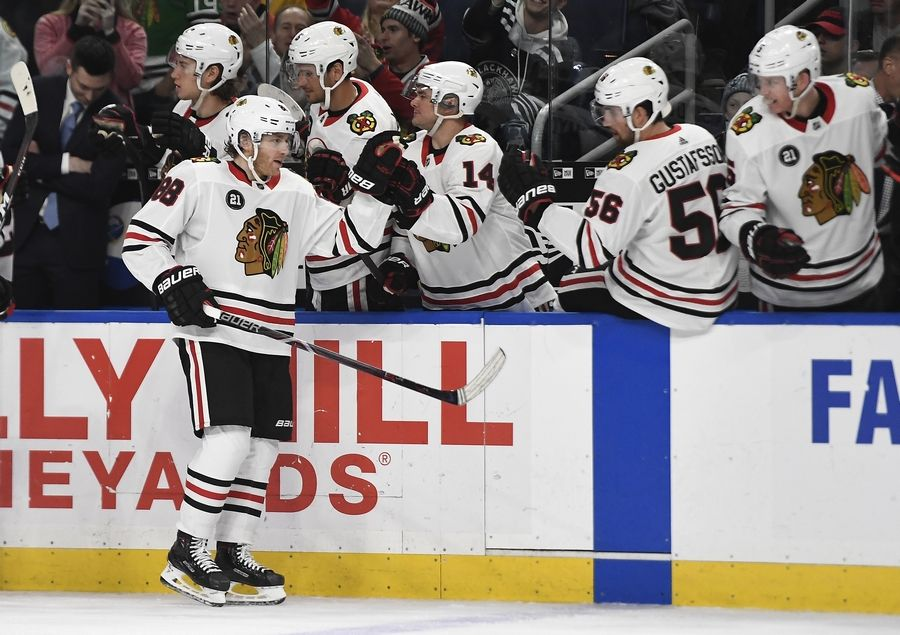 promo code d35c8 6a5f1 Blackhawks right wing Patrick Kane is congratulated by teammates after  scoring during the third period against