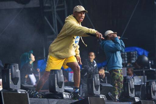 FILE - In this June 3, 2018 file photo, Pharrell Williams of N.E.R.D. performs at The Governors Ball Music Festival at Randall's Island Park in New York. The Recording Academy's Task Force on Diversity and Inclusion is a launching a new initiative announced Friday, Feb. 1, 2019, to create and expand more opportunities to female music producers and engineers. More than 200 musicians, labels and others have already pledged, including Lady Gaga, Justin Bieber, Pearl Jam, Pharrell and Ariana Grande. (Photo by Scott Roth/Invision/AP, File)