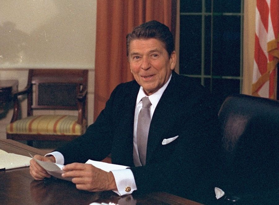 President Ronald Reagan wore a suit and tie in this Oval Office portrait but didn't always wear a jacket to enter the room, though the false claim has been repeated by many.