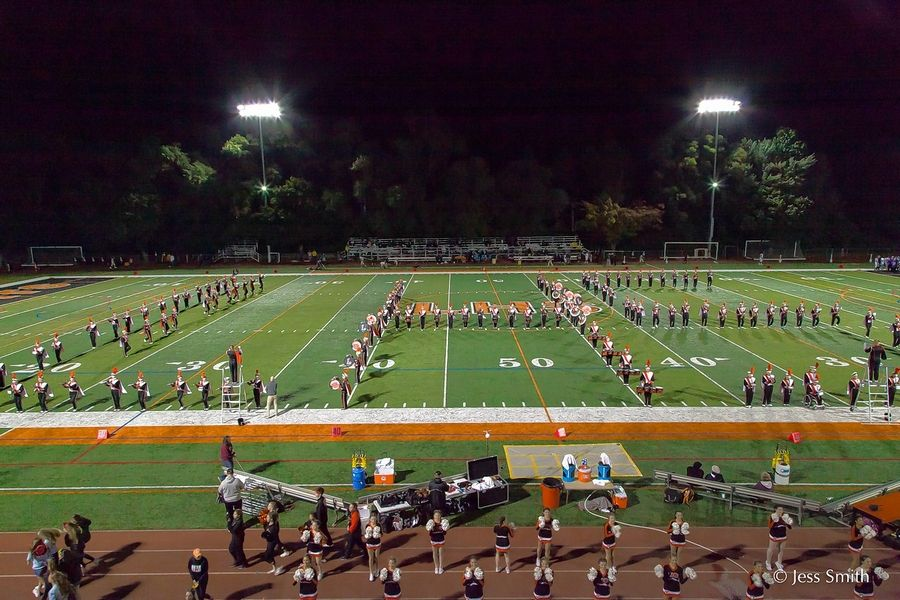 The Libertyville High School marching band spells out the school's initials during a performance. The band will play at the 2020 Outback Bowl in Florida.