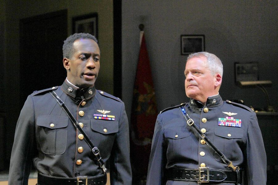 "Capt. Lee King (David Goodloe) shares his reluctance to accept a promotion from Lt. Col. Littlefield (Bryan Burke) in Buffalo Theatre Ensemble's production of John Patrick Shanley's ""Defiance"" at the McAninch Arts Center in Glen Ellyn."