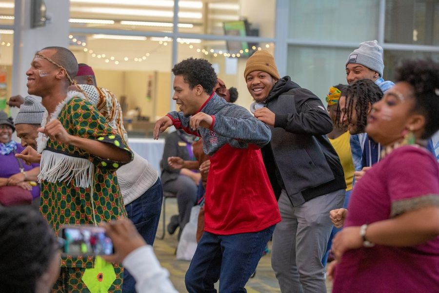College of DuPage students join members of the Afrikan Dance & Music Institute in dance at the college's Black History Month opening celebration Feb. 4.