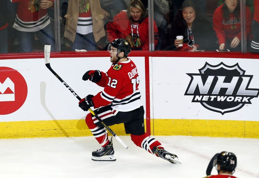 Blackhawks left wing Alex DeBrincat celebrates after his goal against the Vancouver Canucks during the second period on Thursday at the United Center. Optimism has returned for the moment and just like that the Hawks season has meaning again.