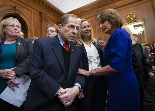 In this file photo from Friday, Jan. 4, 2019, Speaker of the House Nancy Pelosi, D-Calif., right, has a quick word with Rep. Jerrold Nadler, D-N.Y., center, chairman of the House Judiciary Committee, at the Capitol in Washington. Nadler says that he believes President Donald Trump obstructed justice and that House Democrats are requesting documents from scores of people from Trump's administration, family and business as part of the Russia probe. Nadler says the House Judiciary Committee on Monday is requesting documents from the Justice Department, Donald Trump Jr. and Trump Organization executive Alan Weisselberg.