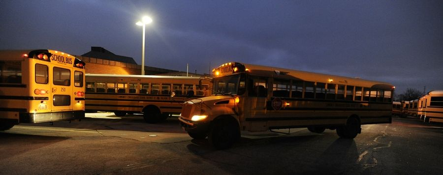Palatine Township Elementary District 15 buses roll out before the sun comes up. School officials and industry experts say a strong job market has made it challenging to find enough drivers to fill their needs.