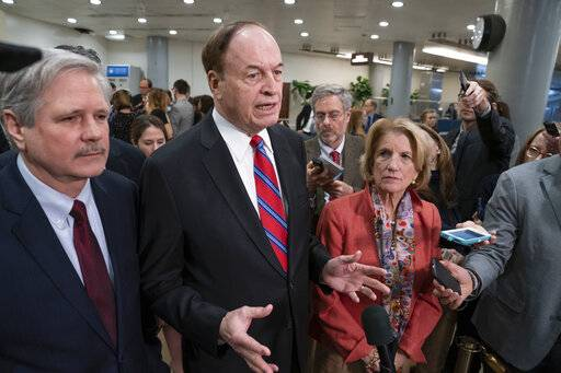 In this Feb. 6, 2019, photo, Sen. Richard Shelby, R-Ala., the top Republican on the bipartisan group bargainers working to craft a border security compromise in hope of avoiding another government shutdown, is joined by Sen. John Hoeven, R-N.D., left, and Sen. Shelley Moore Capito, R-W.Va., right, as they speak with reporters in Washington. Congressional bargainers seem close to clinching a border security agreement that would avert a fresh government shutdown, with leaders of both parties voicing optimism and the top GOP negotiator saying he believes President Donald Trump would back the emerging accord.