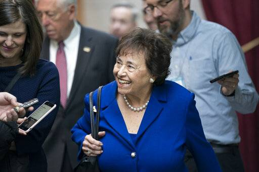 In this Feb. 6, 2019, photo House Appropriations Committee Chair Nita Lowey, D-N.Y., head of the bipartisan group of House and Senate bargainers trying to negotiate a border security compromise in hope of avoiding another government shutdown, walks with reporters to a Democratic Caucus on Capitol Hill in Washington. Congressional bargainers seem close to clinching a border security agreement that would avert a fresh government shutdown, with leaders of both parties voicing optimism and the top GOP negotiator saying he believes President Donald Trump would back the emerging accord.