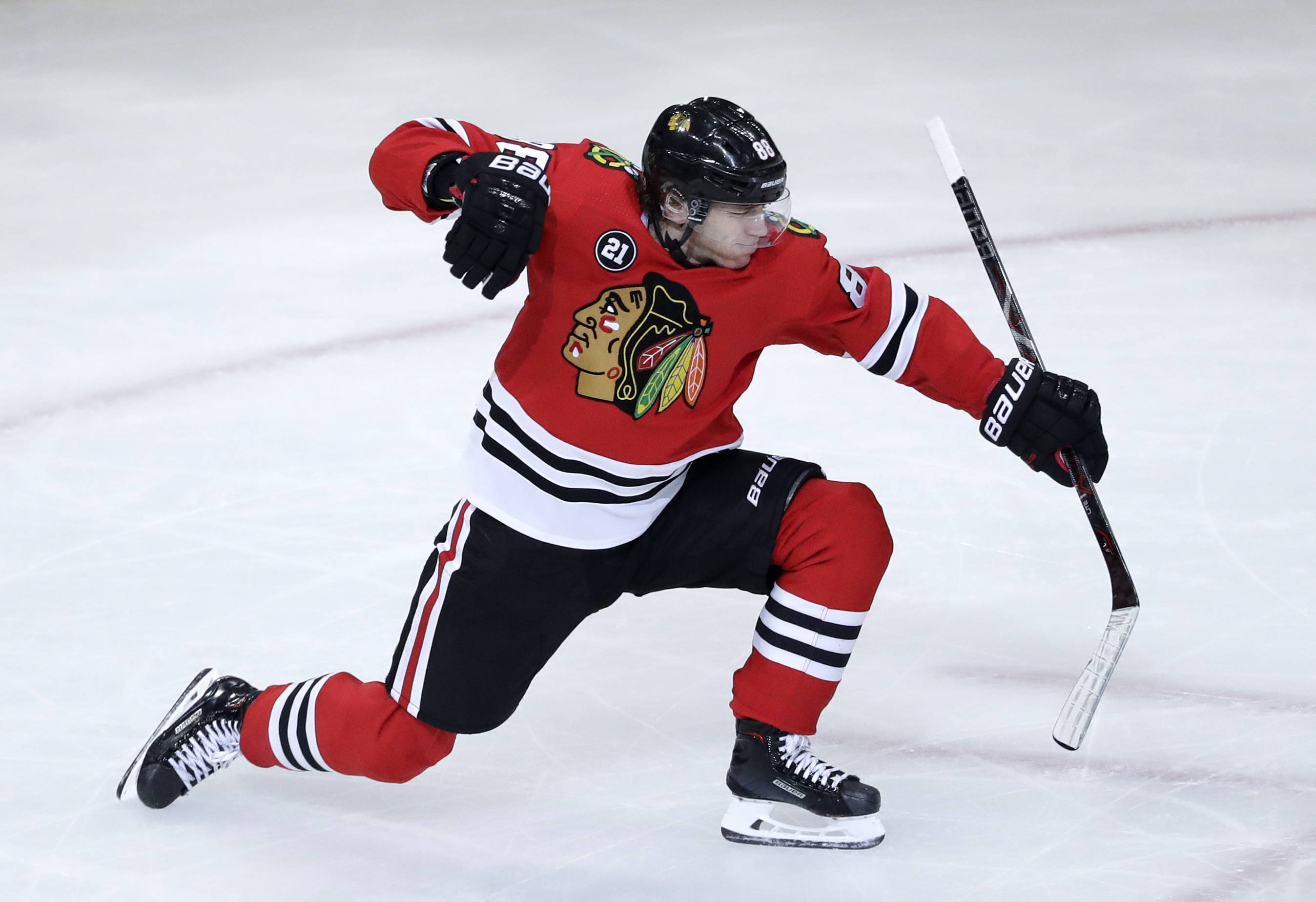 Chicago Blackhawks right wing Patrick Kane celebrates after scoring a goal against the Detroit Red Wings during the third period of an NHL hockey game Sunday, Feb. 10, 2019, in Chicago.