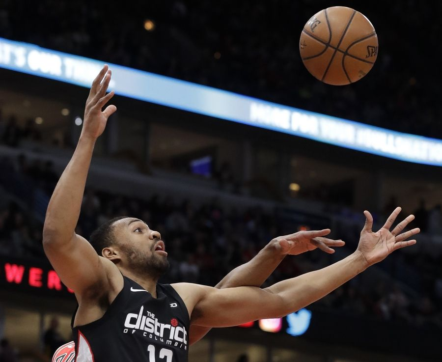 Washington Wizards forward Jabari Parker (12) battles for a rebound against Chicago Bulls forward/center Cristiano Felicio during the first half of an NBA basketball game Saturday, Feb. 9, 2019, in Chicago.