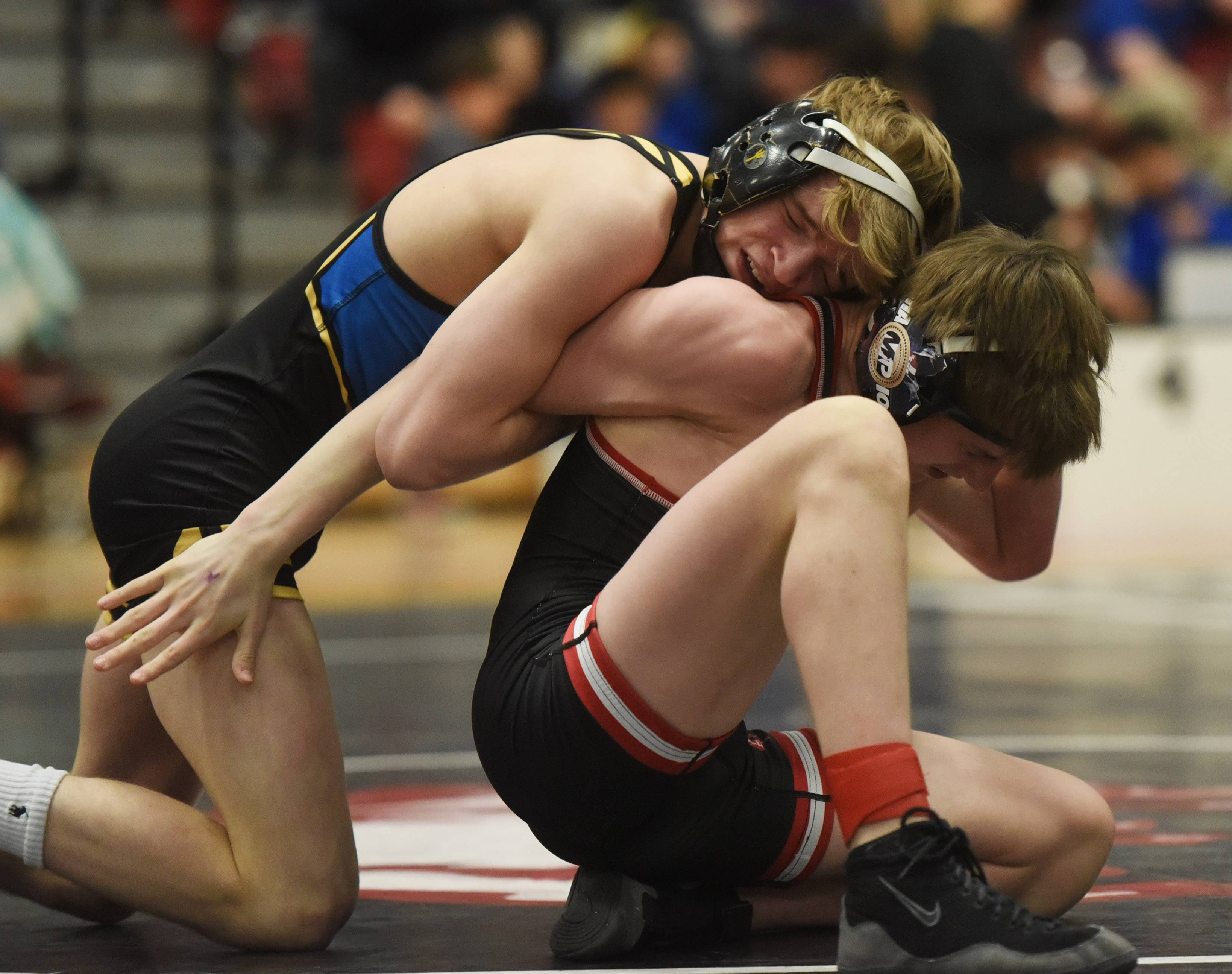 Warren's Sawyer Nash, left, wrestles Barrington's Brian Beers in the 106-pound final of the Barrington wrestling sectional Saturday.