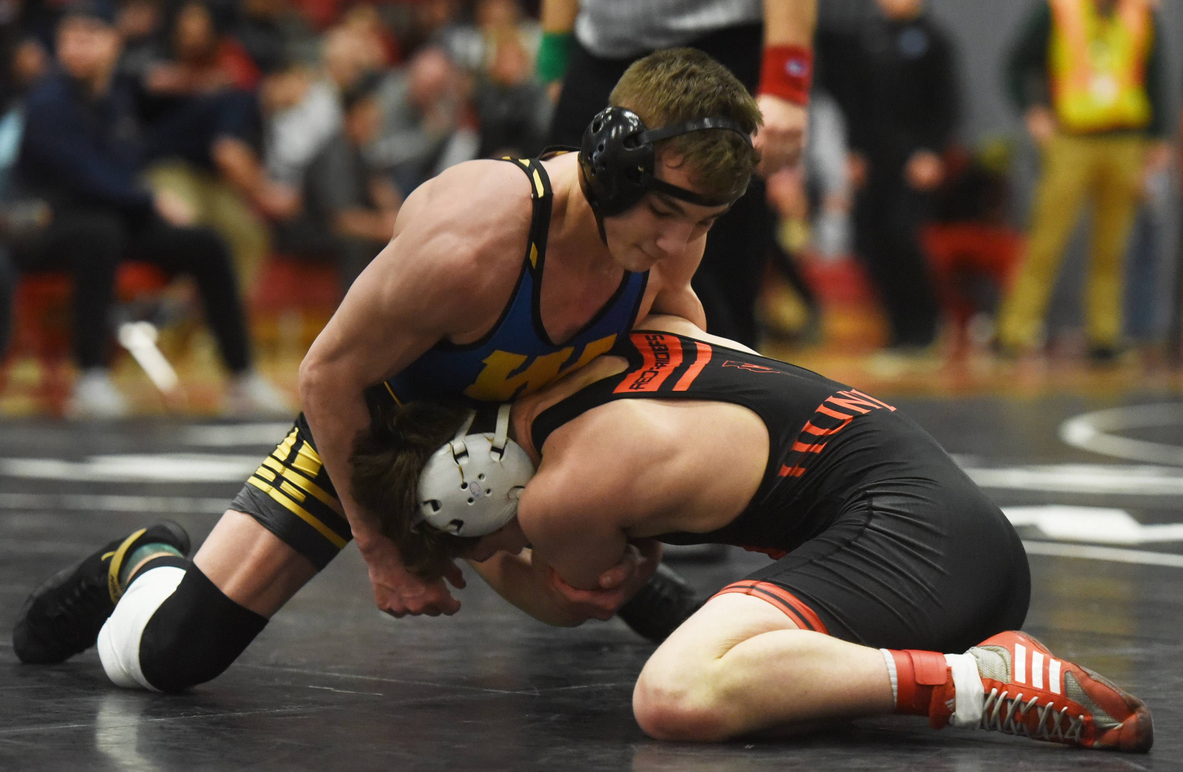 Warren's Joel Vandervere, top wrestles Huntley's Sam Spencer during the 126-pound final of the Barrington wrestling sectional Saturday.