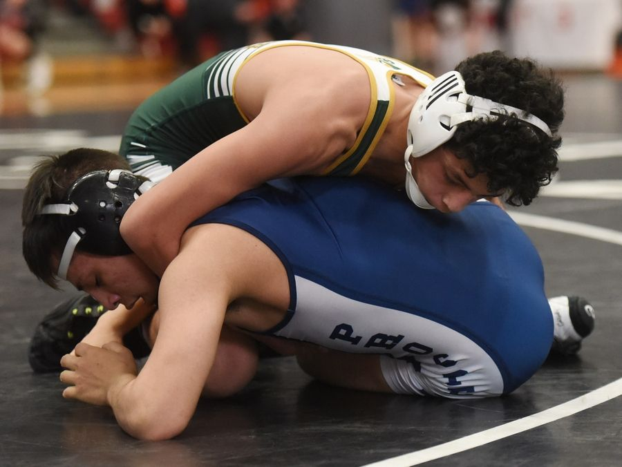 Stevenson's Cole Rhemrev, top, competes with Prospect's Marcus Santos in a 106-pound match during the Barrington wrestling sectional Saturday.