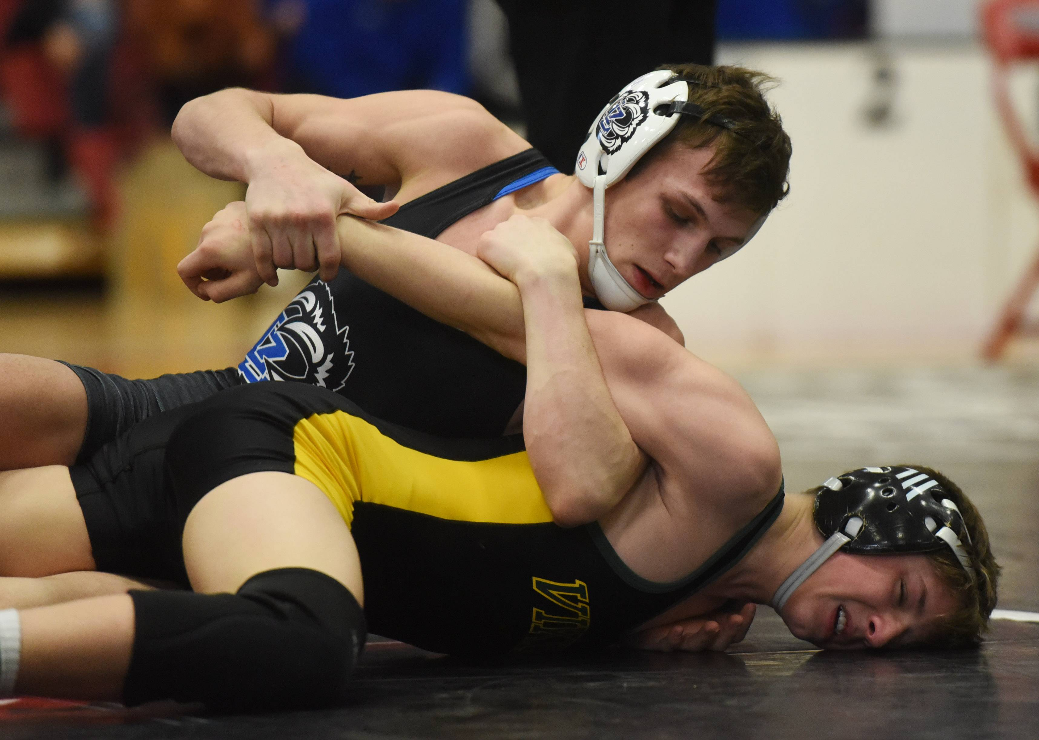 Lake Zurich's Ian McGee, top, competes with Fremd's Charlie Fiffield in a 113-pound match during the Barrington wrestling sectional Saturday.
