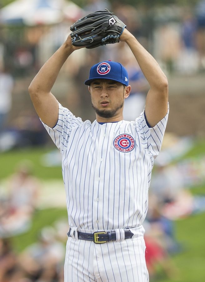 Yu Darvish -- on a rehab assignment with the Cubs' class A affiliate -- warms up against the Great Lakes Loons at a South Bend Cubs baseball game on Aug. 19 in South Bend, Ind. Darvish made only 8 starts last season after signing a six-year contract worth $126 million.