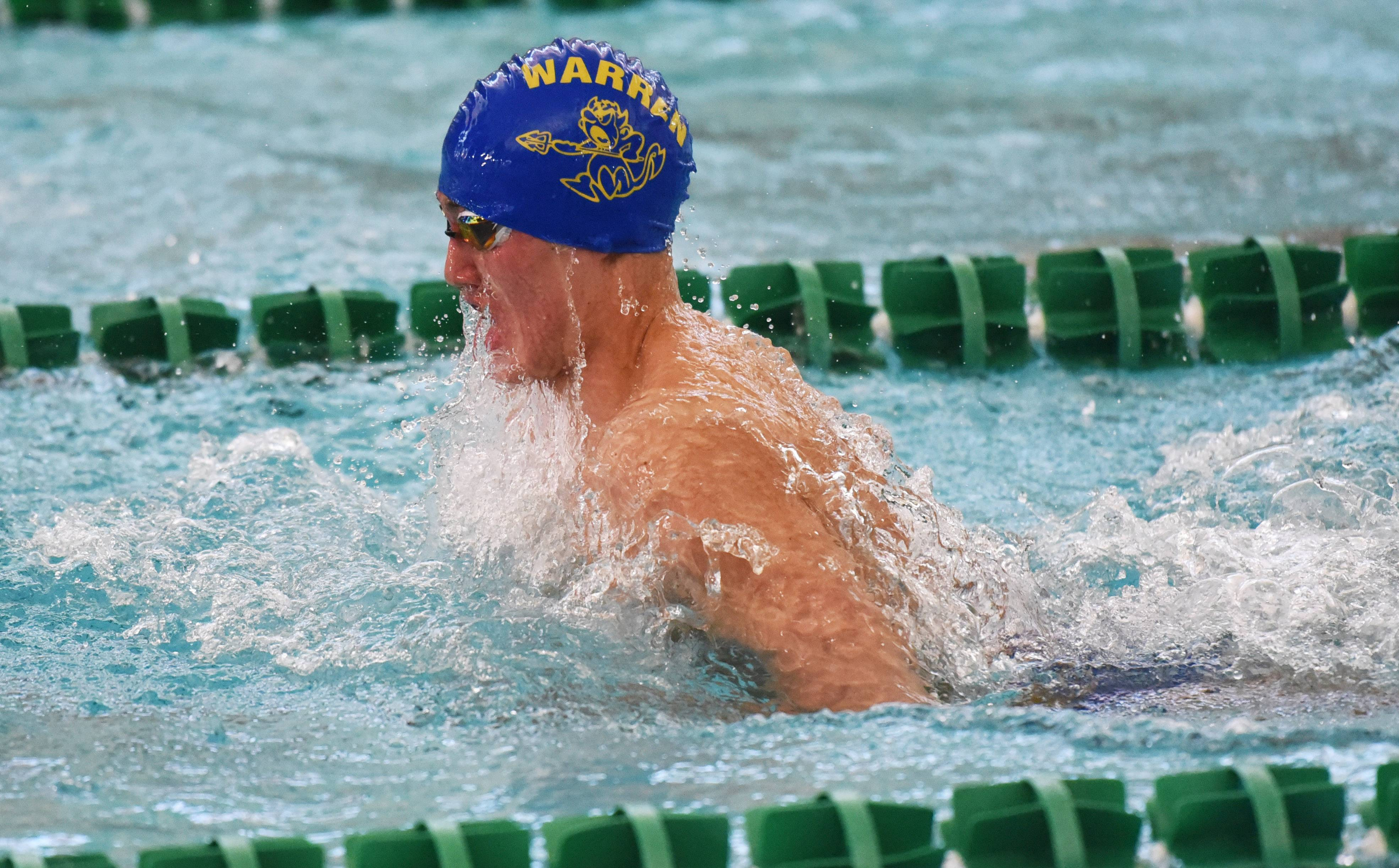 Warren's Taylor Vander-Jeugdt swims the breaststroke leg of his teams's 200-yard medley relay event during the NSC swim meet Saturday at Stevenson High School in Lincolnshire.