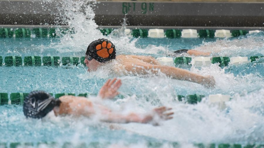Libertyville's Richie Rush, top, competes in the 200-yard IM during the NSC swim meet Saturday at Stevenson High School in Lincolnshire.
