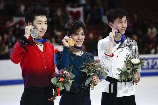 From left; silver medal winner Boyang Jin, of China, gold medal winner, Shoma Uno, of Japan, and bronze medal winner, Vincent Zhou, of the United States, pose at the Four Continents Figure Skating Championships on Saturday, Feb. 9, 2019, in Anaheim, Calif.