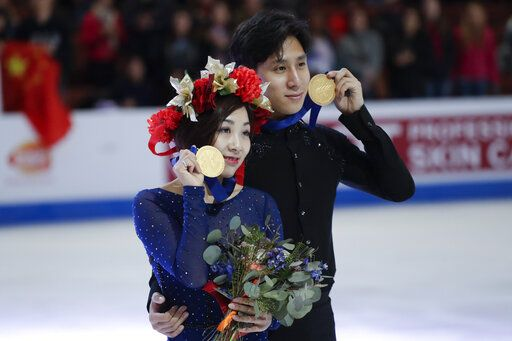 Wenjing Sui and Cong Han, of China, hold their gold medals after winning the pairs competition at the Four Continents Figure Skating Championships on Saturday, Feb. 9, 2019, in Anaheim, Calif.