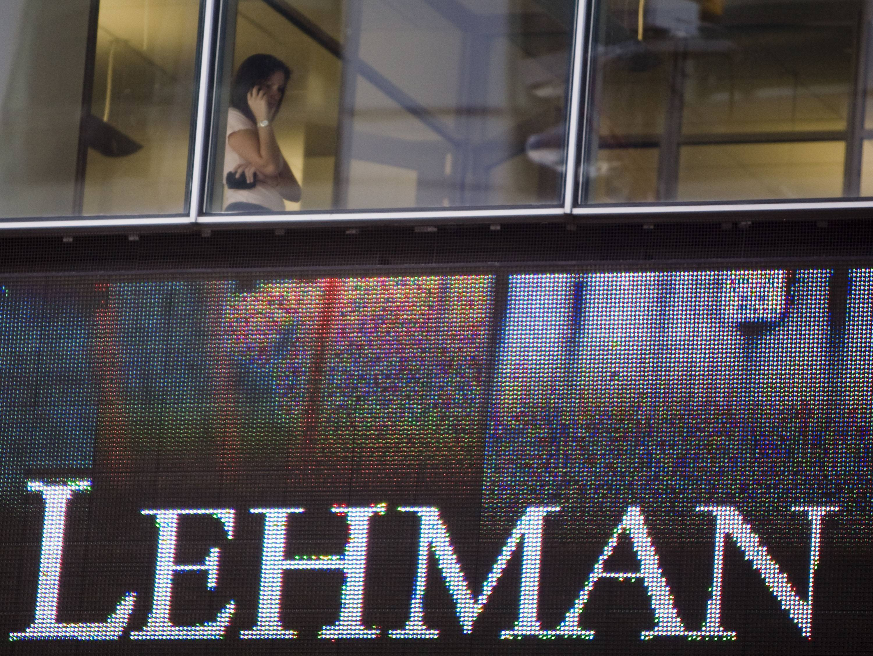 A woman speaks on a cellphone inside the headquarters of Lehman Brothers in New York in Sept. 2008.