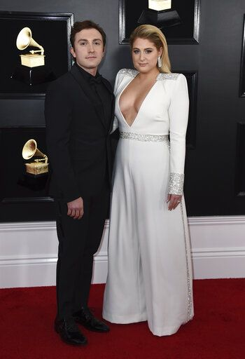 Daryl Sabara, left, and Meghan Trainor arrive at the 61st annual Grammy Awards at the Staples Center on Sunday, Feb. 10, 2019, in Los Angeles. (Photo by Jordan Strauss/Invision/AP)