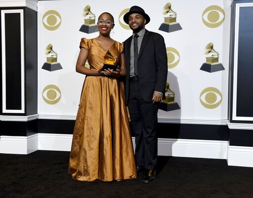 "Cecile McLorin Salvant, left, and Sullivan Fortner pose in the press room with the award for best jazz vocal album for ""The Window"" at the 61st annual Grammy Awards at the Staples Center on Sunday, Feb. 10, 2019, in Los Angeles. (Photo by Chris Pizzello/Invision/AP)"