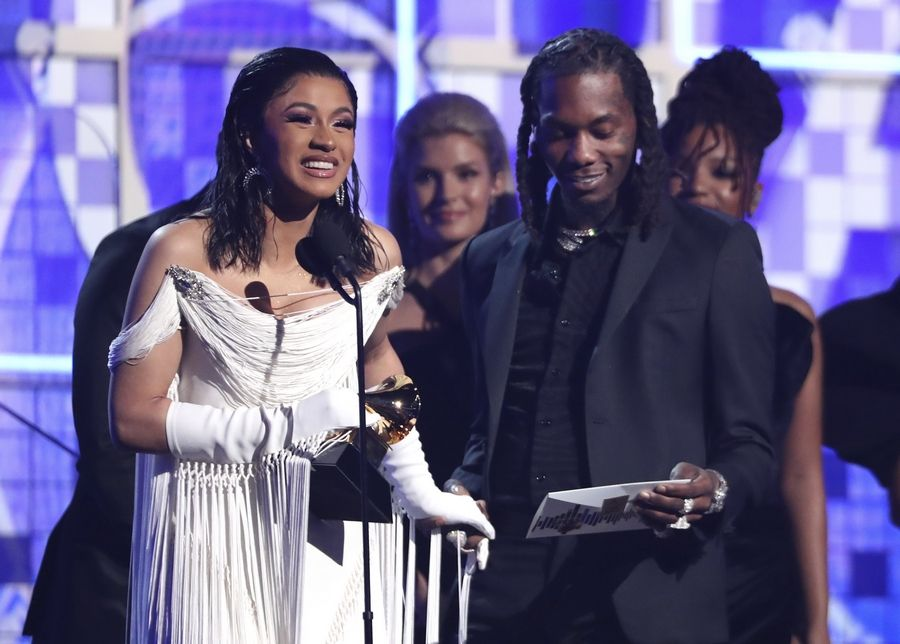 "Cardi B, left, accepts the award for best rap album for ""Invasion of Privacy"" as Offset looks on at the 61st annual Grammy Awards on Sunday, Feb. 10, 2019, in Los Angeles."