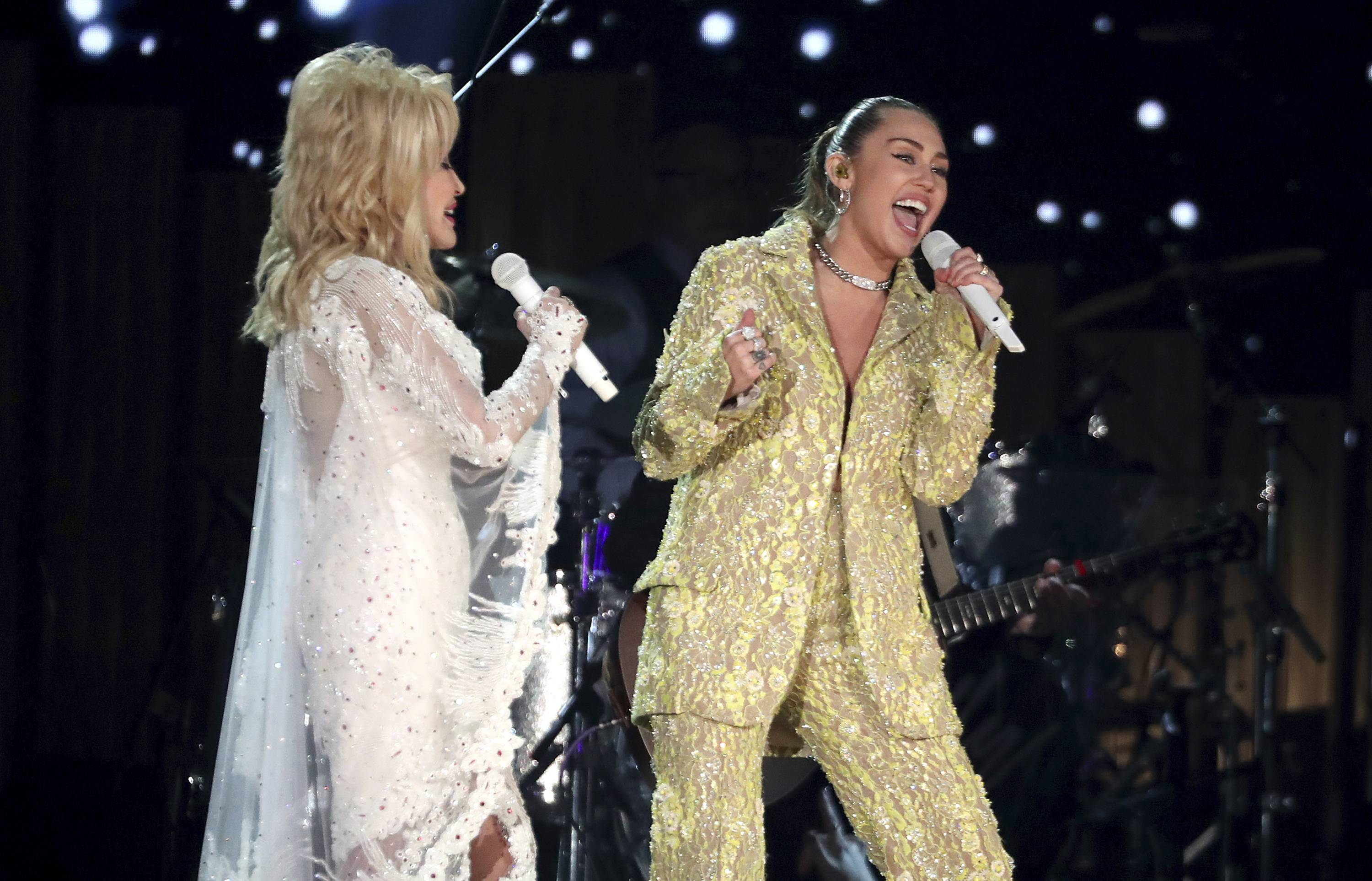 "Dolly Parton, left, and Miley Cyrus perform ""Jolene"" at the 61st annual Grammy Awards on Sunday, Feb. 10, 2019, in Los Angeles."