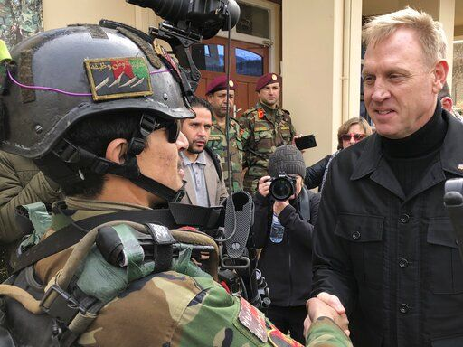 Acting Secretary of Defense Pat Shanahan greets an Afghan commando at Camp Commando, Afghanistan on Monday, Feb. 11, 2019. The unannounced visit is the first for the acting secretary of defense, Pat Shanahan. He previously was the No. 2 official under Jim Mattis, who resigned as defense chief in December.