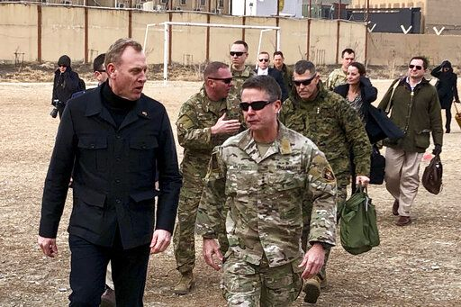Acting Defense Secretary Pat Shanahan, left, arrives in Kabul, Afghanistan, Monday morning, Feb. 11, 2019, to consult with Army Gen. Scott Miller, right, commander of U.S. and coalition forces, and senior Afghan government leaders. The unannounced visit is the first for the acting secretary of defense, Pat Shanahan. He previously was the No. 2 official under Jim Mattis, who resigned as defense chief in December.