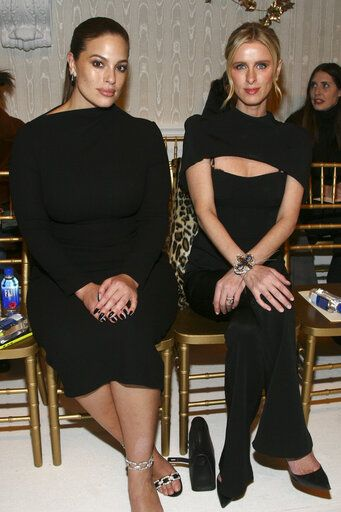 Ashley Graham, left, and Nicky Hilton Rothschild, right, attend the NYFW Fall/Winter 2019 Brandon Maxwell fashion show at Hotel Pennsylvania on Saturday, Feb. 9, 2019, in New York. (Photo by Andy Kropa/Invision/AP)