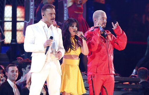 "Ricky Martin, from left, Camila Cabello and J Balvin perform ""Havana"" at the 61st annual Grammy Awards on Sunday, Feb. 10, 2019, in Los Angeles. (Photo by Matt Sayles/Invision/AP)"