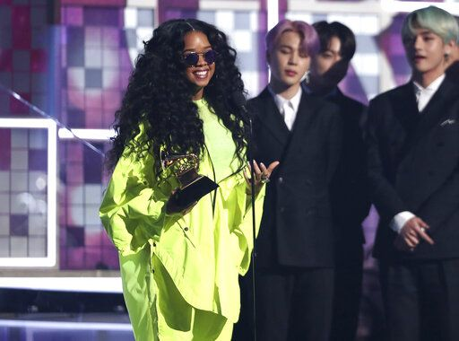 "H.E.R. accepts the award for best R&B album for ""H.E.R."" at the 61st annual Grammy Awards on Sunday, Feb. 10, 2019, in Los Angeles. (Photo by Matt Sayles/Invision/AP)"