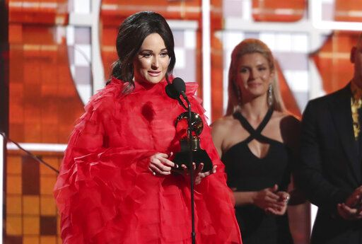 "Kacey Musgraves accepts the award for best country album for ""Golden Hour"" at the 61st annual Grammy Awards on Sunday, Feb. 10, 2019, in Los Angeles. (Photo by Matt Sayles/Invision/AP)"