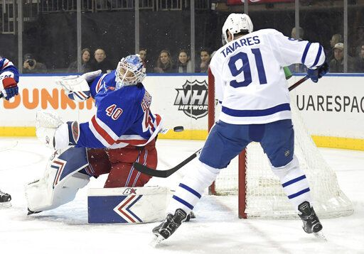New York Rangers goaltender Alexandar Georgiev (40) eyes the puck as Toronto Maple Leafs center John Tavares (91) attempts to get his stick on the puck during the first period of an NHL hockey game Sunday, Feb. 10, 2019, at Madison Square Garden in New York.
