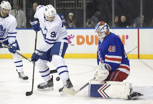 New York Rangers goaltender Alexandar Georgiev (40) makes a save as Toronto Maple Leafs center John Tavares (91) looks for the rebound during the first period of an NHL hockey game Sunday, Feb. 10, 2019, at Madison Square Garden in New York.
