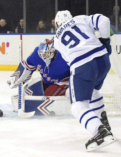 New York Rangers goaltender Alexandar Georgiev (40) makes a save on a shot by Toronto Maple Leafs center John Tavares (91) during the first period of an NHL hockey game Sunday, Feb. 10, 2019, at Madison Square Garden in New York.