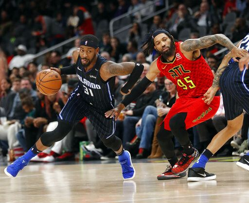 Orlando Magic guard Terrence Ross (31) drives past Atlanta Hawks forward DeAndre' Bembry (95) during the second half of an NBA basketball game Sunday, Feb. 10, 2019, in Atlanta. Orlando won 124-108.