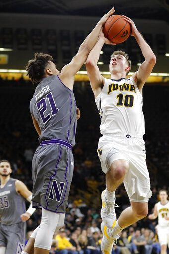 Iowa guard Joe Wieskamp (10) shoots over Northwestern forward A.J. Turner (21) during the second half of an NCAA college basketball game, Sunday, Feb. 10, 2019, in Iowa City, Iowa. Iowa won 80-79.